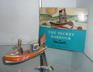 Sam Smith, Fishing Boat 'S71', wood with enamelling and mixed media, 1971, 20cm long. And Smith's book 'The Secret Harbour', Ernest Benn Limited, London and Tonbridge,  1975.