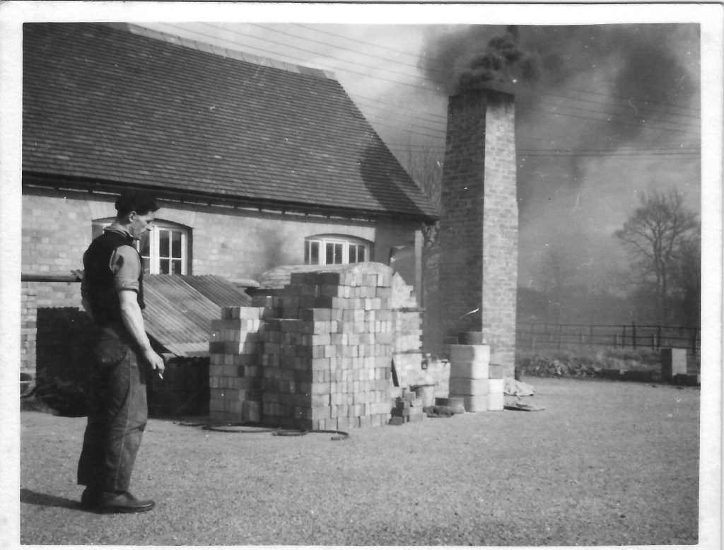 Fire Potter. Geoffrey Whiting testing the chimney for the new kiln. Avoncroft Pottery, 1955